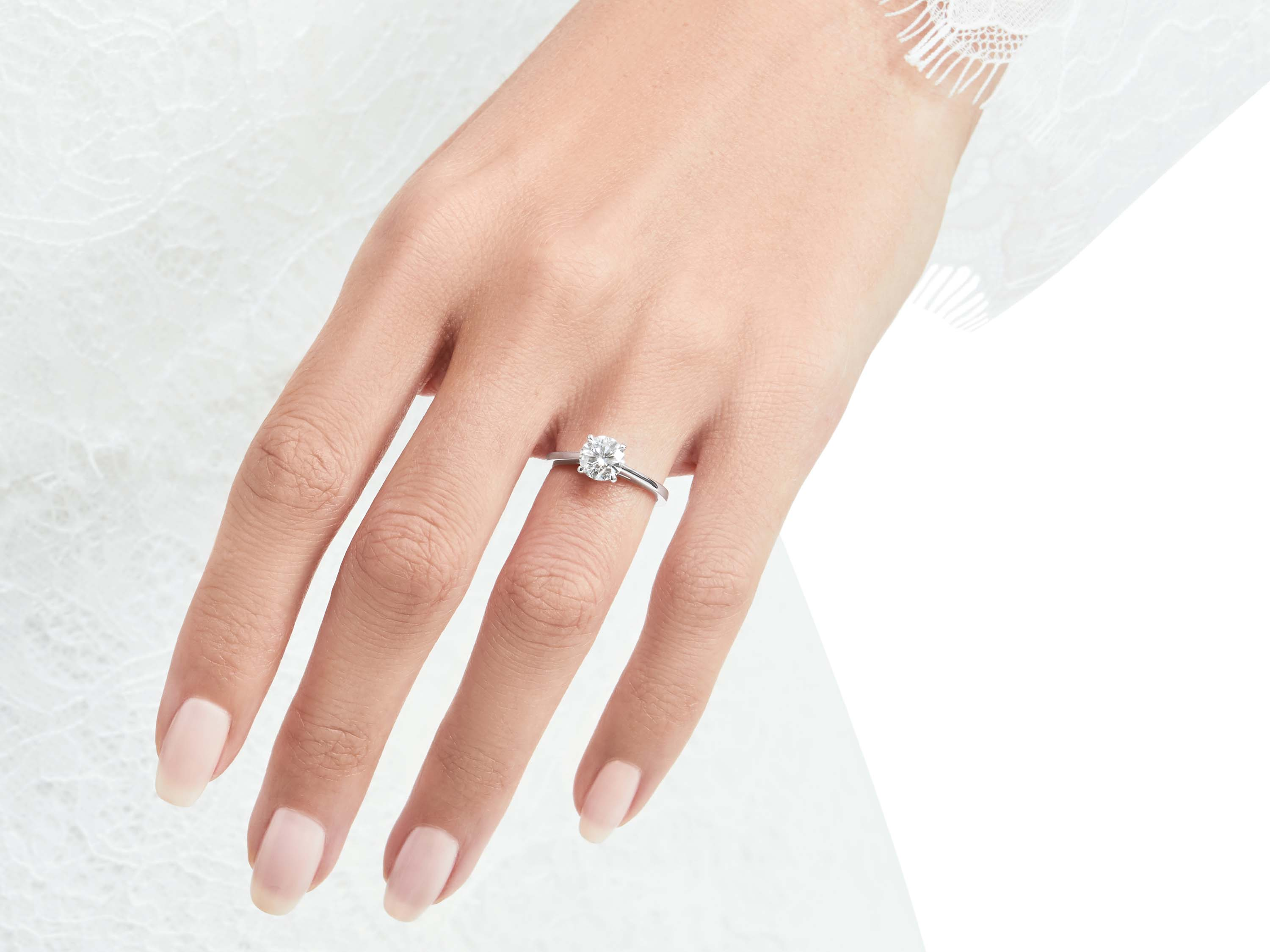 Model wears Paragon Round Diamond Engagement Ring from the Graff bridal jewellery collection