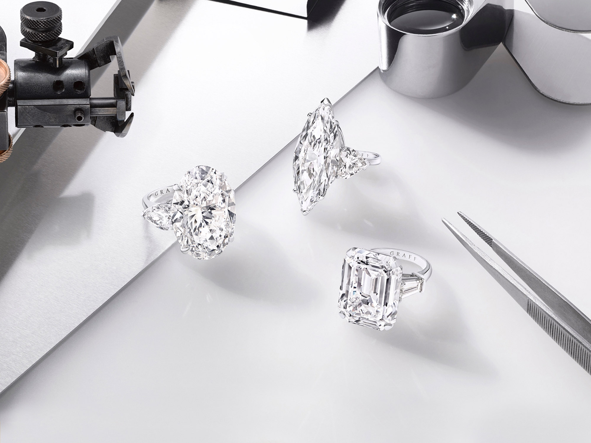 Three Graff Promise engagement rings set with Oval shape diamond, Marquise Shape Diamond and Emerald Cut Diamond.