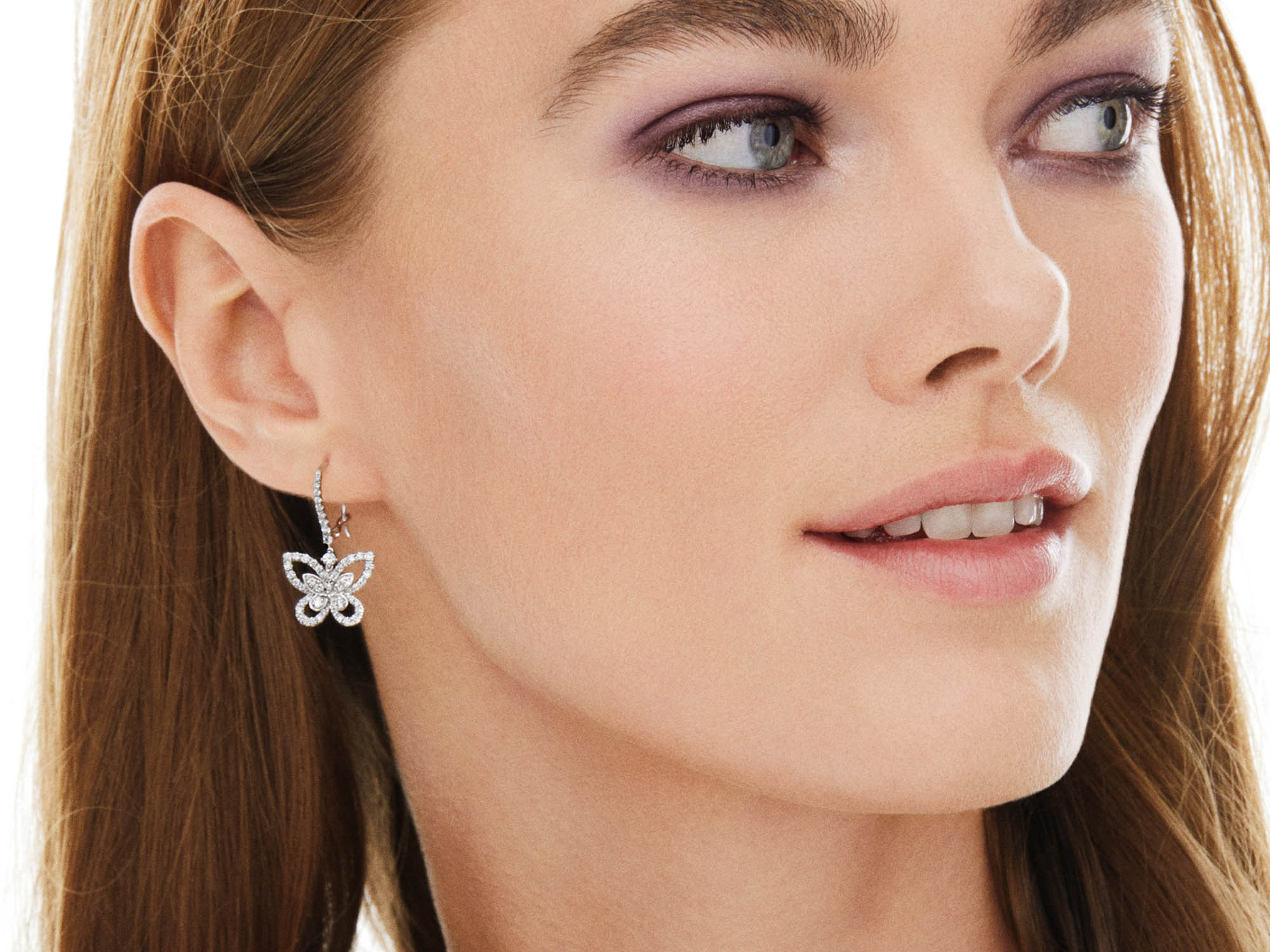 Model wears Butterfly Silhouette Diamond Drop Earrings from the Graff jewellery collection