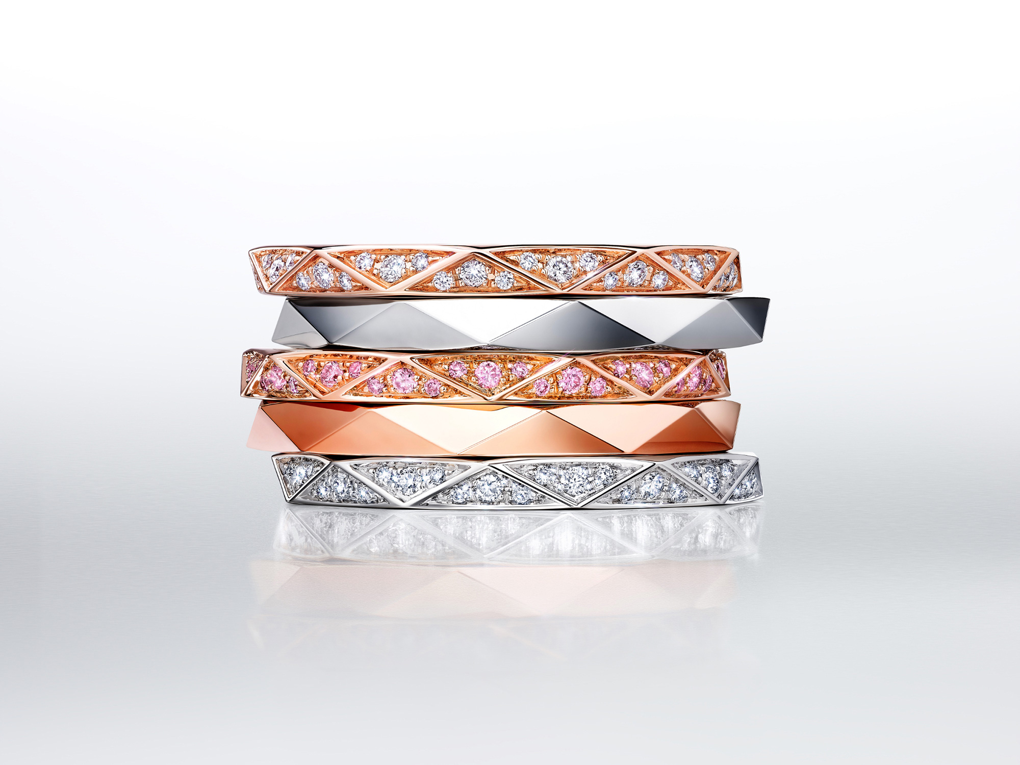 Stacked Laurence Graff signature bands in white Gold and rose gold, set with dIamond paves or plain