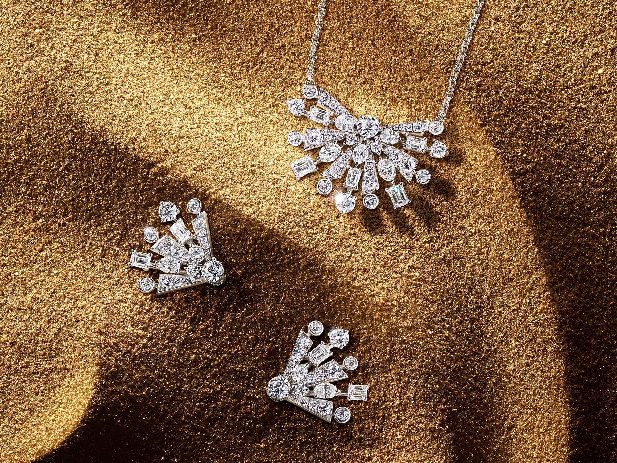 The Graff New Dawn diamond earrings and pendant from the Tribal jewellery collection, on sand