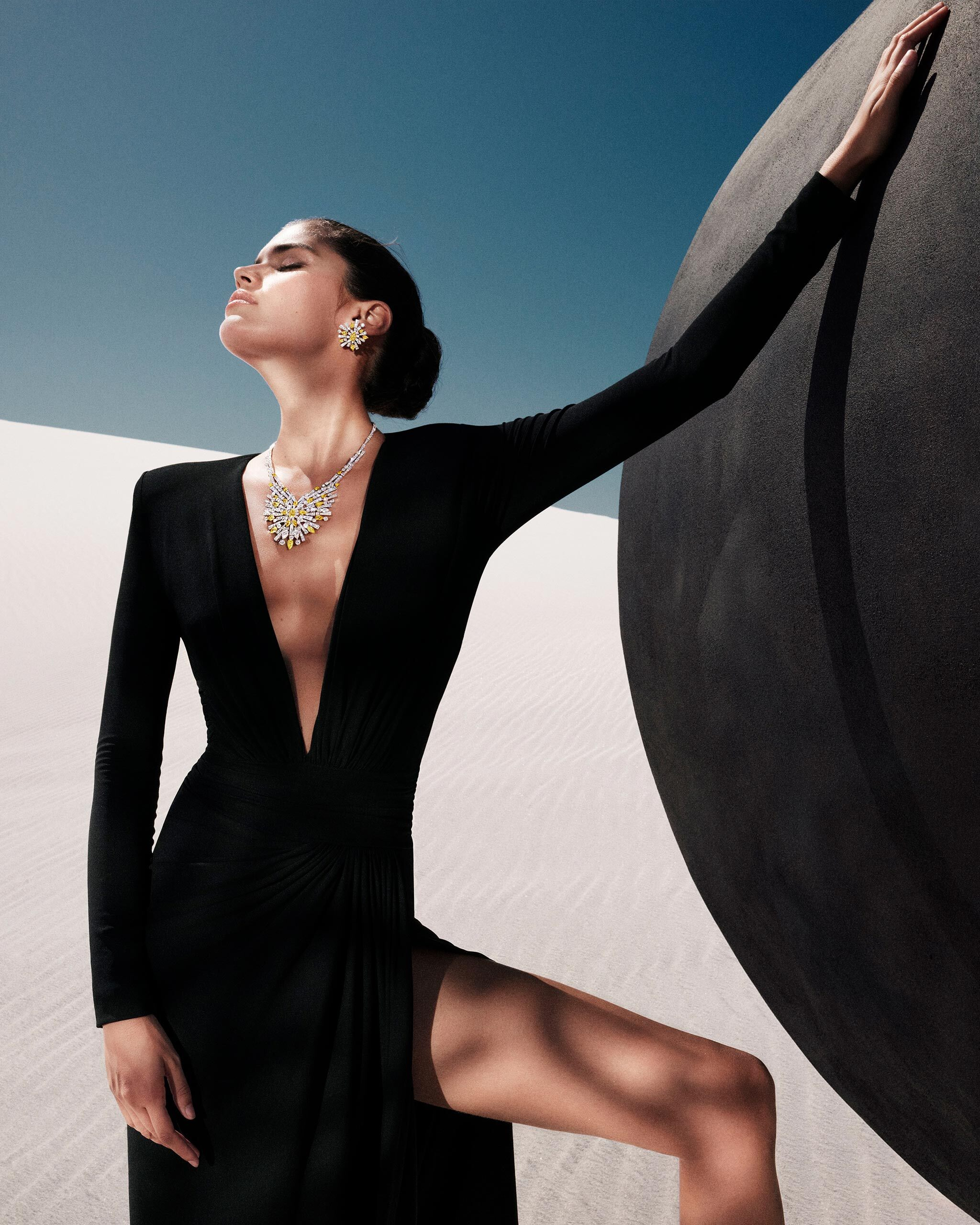 Model wears New Dawn diamond jewels from the Graff Tribal collection, in a desert