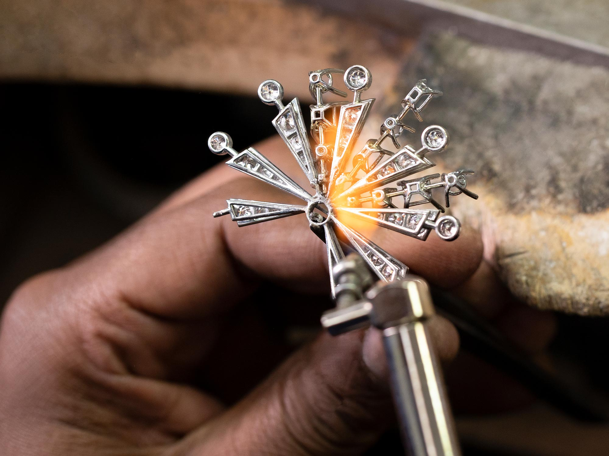Close up of a Graff craftsman making a New Dawn motif from the Tribal jewellery collection in the workshop