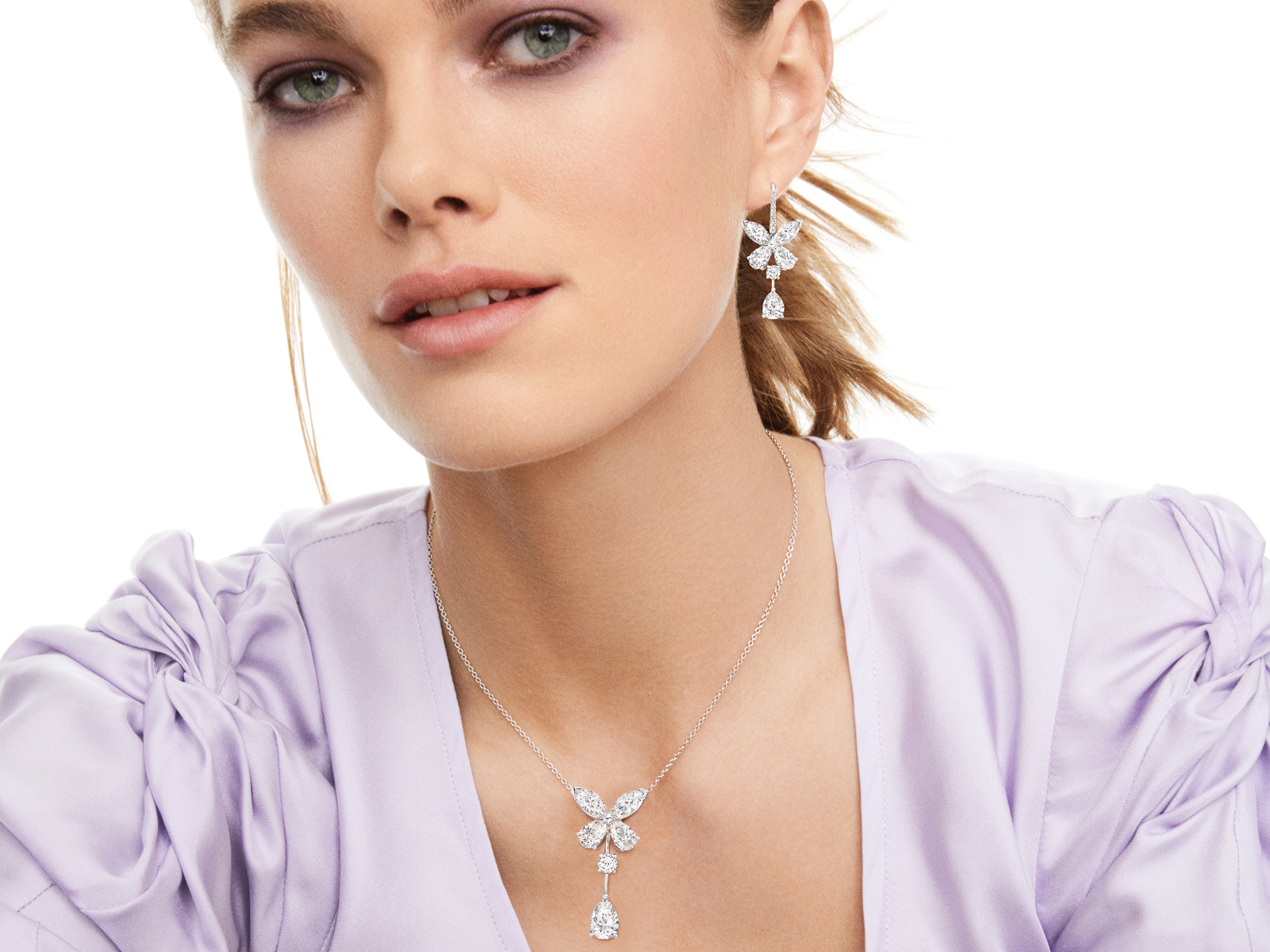 Model wearing Graff Classic Butterfly Single Motif Pear Shape Diamond Drop Pendant and Classic Butterfly Diamond Drop Earrings