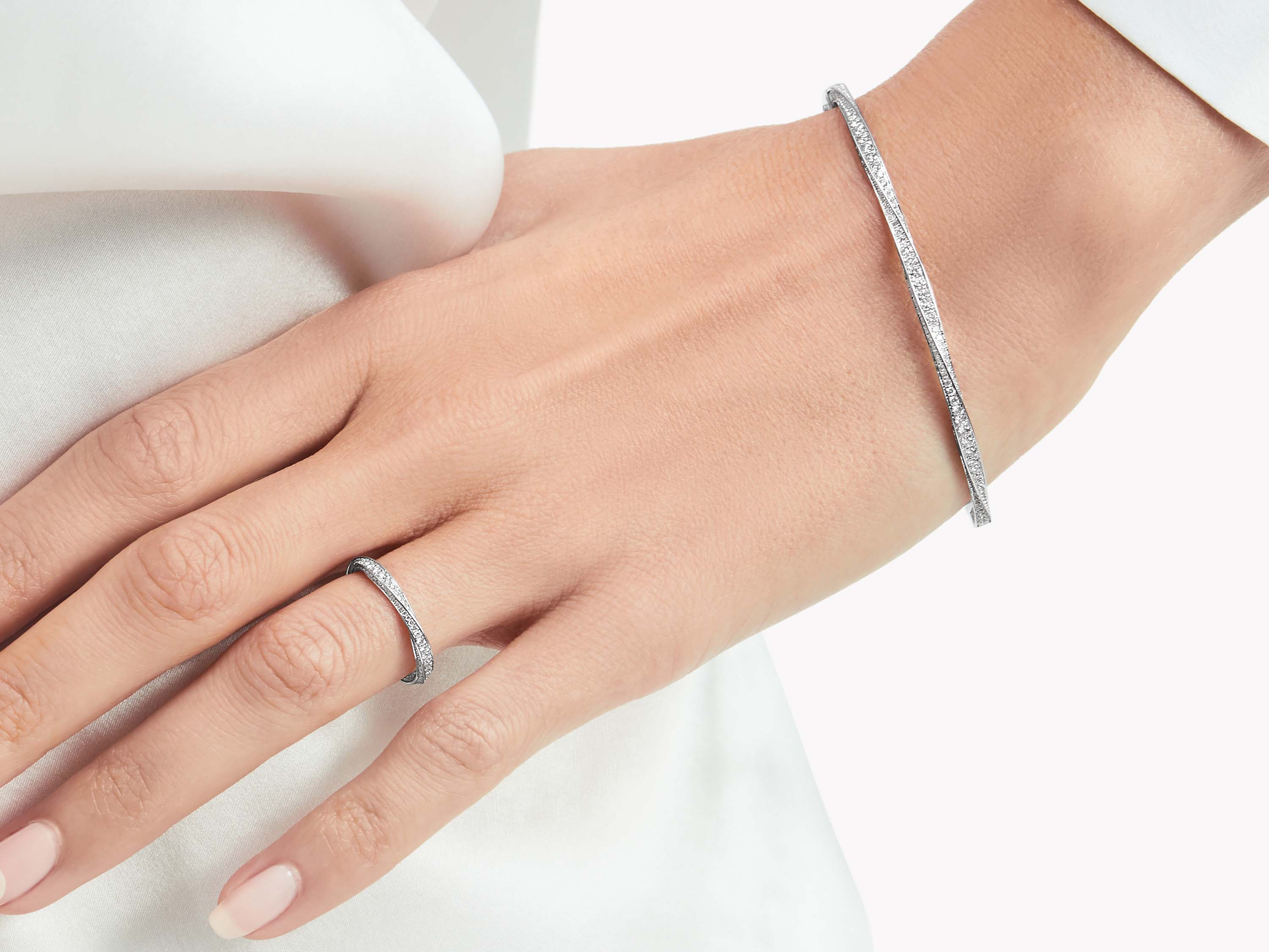 Model wearing Graff Spiral Pavé Diamond Bangle and Spiral Pavé Diamond Band