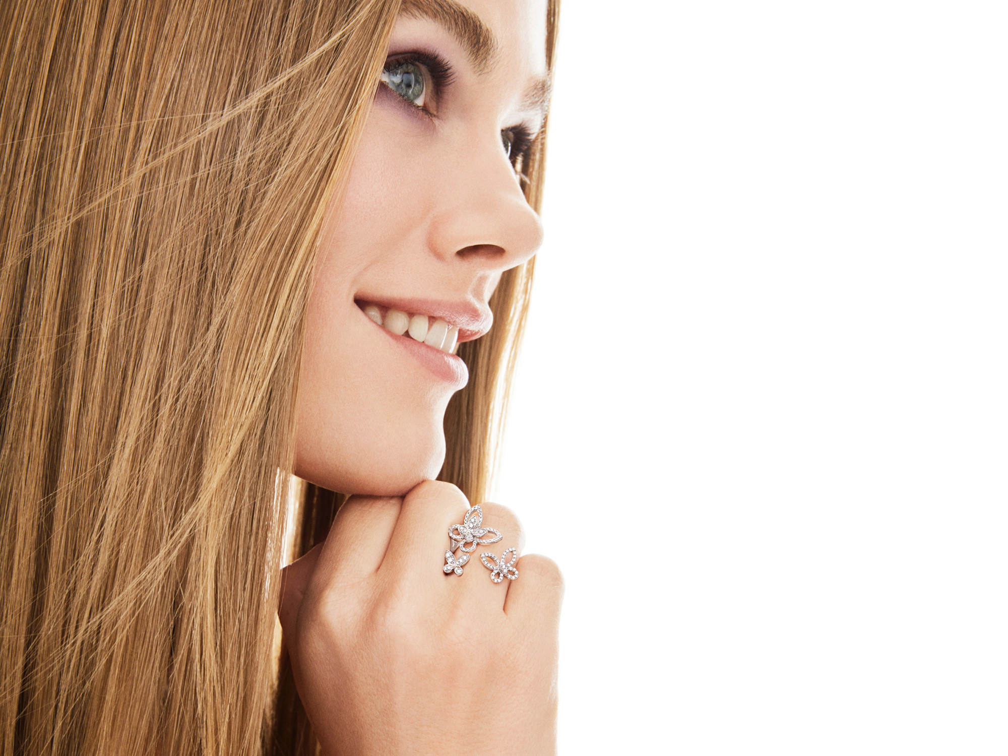 Model wearing Triple Butterfly Silhouette Diamond Ring from the Graff jewellery collection