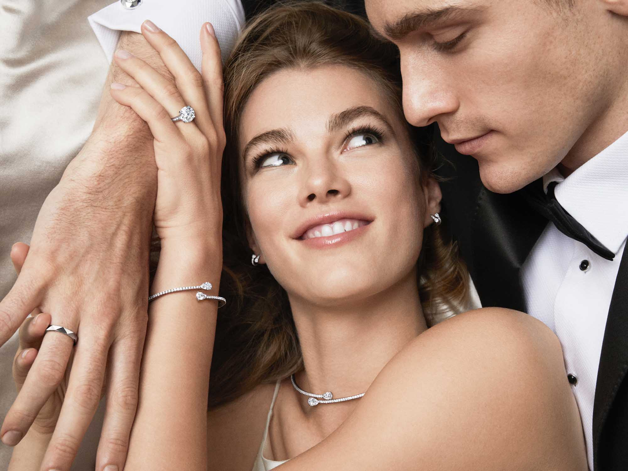 Bride wears Graff Duet jewellery collection necklace, ring, bracelet and round diamond solitaire and groom wears Laurence Graff signature white gold ring.